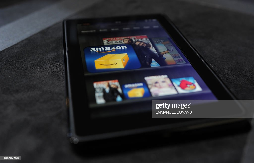 The new Amazon Kindle Fire tablet is displayed at a press conference in New York on September 28, 2011. Amazon CEO Jeff Bezos introduced a line of four new Kindle products, the Kindle Fire tablet, the Kindle Touch 3G, the Kindle Touch and a new lighter and smaller Kindle. AFP PHOTO/Emmanuel Dunand
