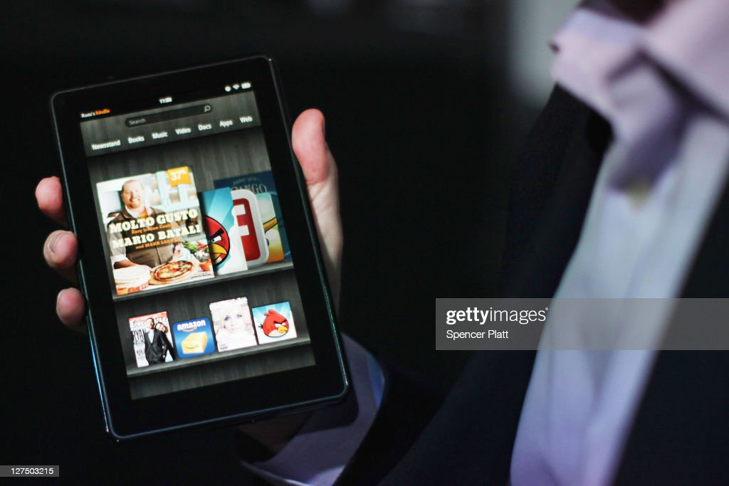 The new Amazon tablet called the Kindle Fire is displayed on September 28, 2011 in New York City. The Fire, which will be priced at $199, is an expanded version of the company's Kindle e-reader that has 8GB of storage and WiFi. The Fire gives users access to streaming video, as well as e-books, apps and music, and has a Web browser. In addition to the Fire, Bezos introduced four new Kindles including a Kindle touch model.