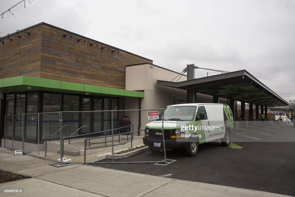 The new Amazon.com Inc. drive-through grocery location sits under construction in the Ballard neighborhood of Seattle, Washington, U.S., on Wednesday, March 8, 2017. Amazon's goal is to become a Top 5 grocery retailer by 2025, according to a person familiar with the matter. That would require more than $30 billion in annual food and beverage spending through its sites, up from $8.7 billion including Amazon Fresh and all other food and drink sales in 2016, according to Cowen & Co. Photographer: David Ryder/Bloomberg via Getty Images