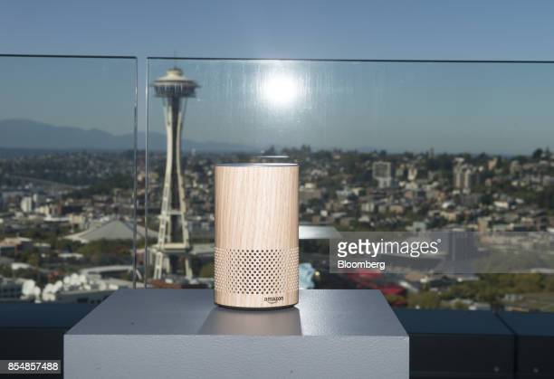 The new Amazoncom Inc Echo device sits on display in front of the Seattle Space Needle during the company's product reveal launch event in downtown...