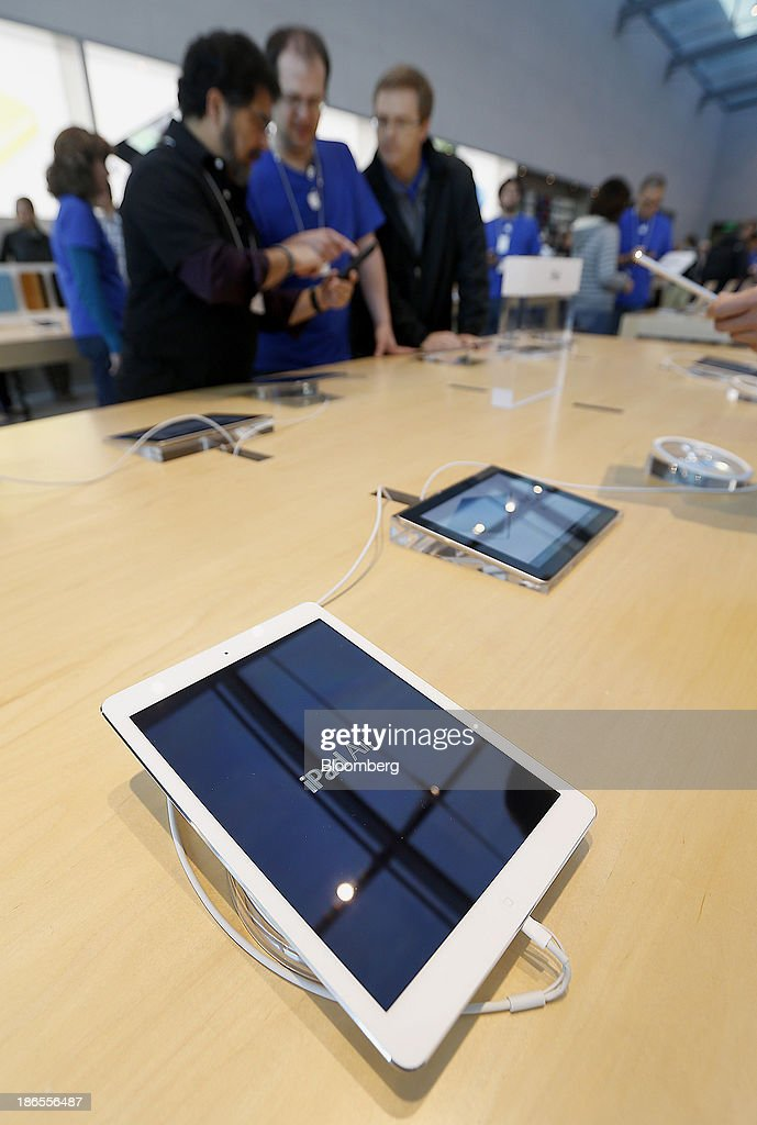 The new Apple Inc. iPad Air is displayed on the first day of sales at a store in Palo Alto, California, U.S., on Friday, Nov. 1, 2013. Apple Inc.'s forecast for the slowest holiday sales growth in a half decade reflects how iPhones and iPads aren't providing the growth surges they once did as competition accelerates in the saturated mobile market. Photographer: Tony Avelar/Bloomberg via Getty Images