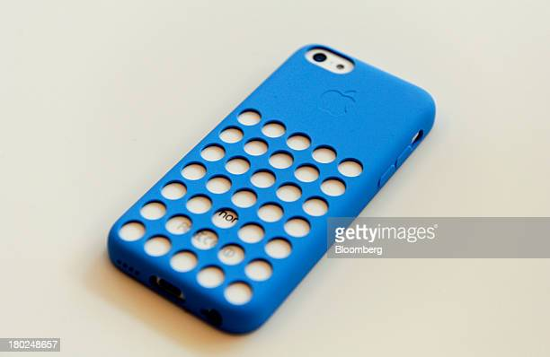 The new Apple Inc iPhone 5C in a new case is arranged for a photograph during a product announcement in Cupertino California US on Tuesday Sept 10...