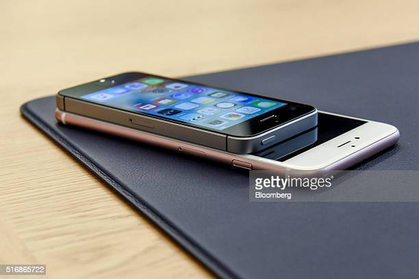 The new Apple Inc iPhone SE smartphone is arranged for a photograph on top of an iPhone 6 Plus after an Apple event in Cupertino California US on...