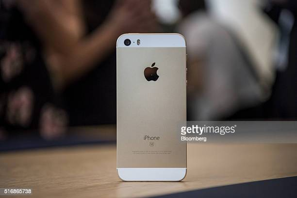 The new Apple Inc iPhone SE smartphone is displayed after an event in Cupertino California US on Monday March 21 2016 Apple Inc unveiled a new...