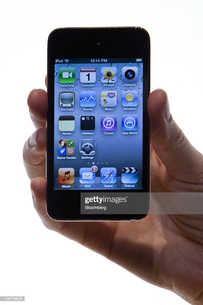The new Apple Inc. iPod Touch is displayed during an Apple product unveiling event in San Francisco, California, U.S., on Wednesday, Sept. 1, 2010. Apple, building on its dominance in the music industry, introduced new iPods, added a social networking feature to its iTunes software, and unveiled a new Apple TV set-top box that offers television and movie rentals. Photographer: David Paul Morris/Bloomberg via Getty Images