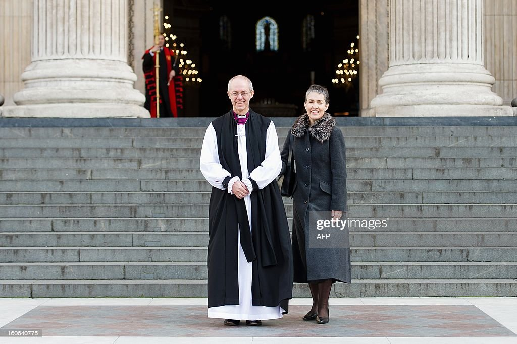 The new Archbishop Of Canterbury Justin Welby (L) leaves St Paul's Cathedral with his wife Caroline after being confirmed into the post of Archbishop on February 4, 2013. The ceremony, known as the Confirmation of Election, forms part of the legal process by which Welby replaces his predecessor, Rowan Williams, as Archbishop of Canterbury. AFP PHOTO/Leon Neal