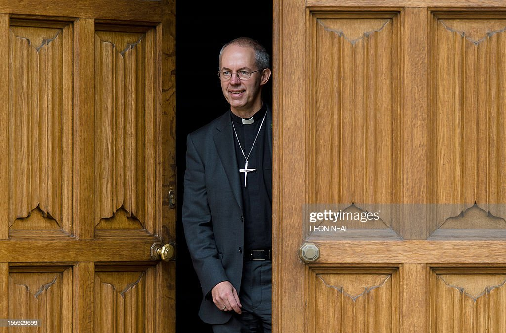 The new Archbishop of Canterbury, Justin Welby, poses for pictures after a press conference in London, on November 9, 2012. Former oil executive Justin Welby was named Friday as the next Archbishop of Canterbury, the spiritual head of the world's Anglicans, in a move aimed at healing schisms over gay and female bishops.