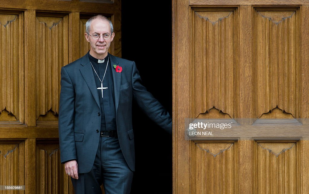 The new Archbishop of Canterbury Justin Welby poses for pictures following a press conference in London, on November 9, 2012. Former oil executive Justin Welby was named Friday as the next Archbishop of Canterbury, the spiritual head of the world's Anglicans, in a move aimed at healing schisms over gay and female bishops.