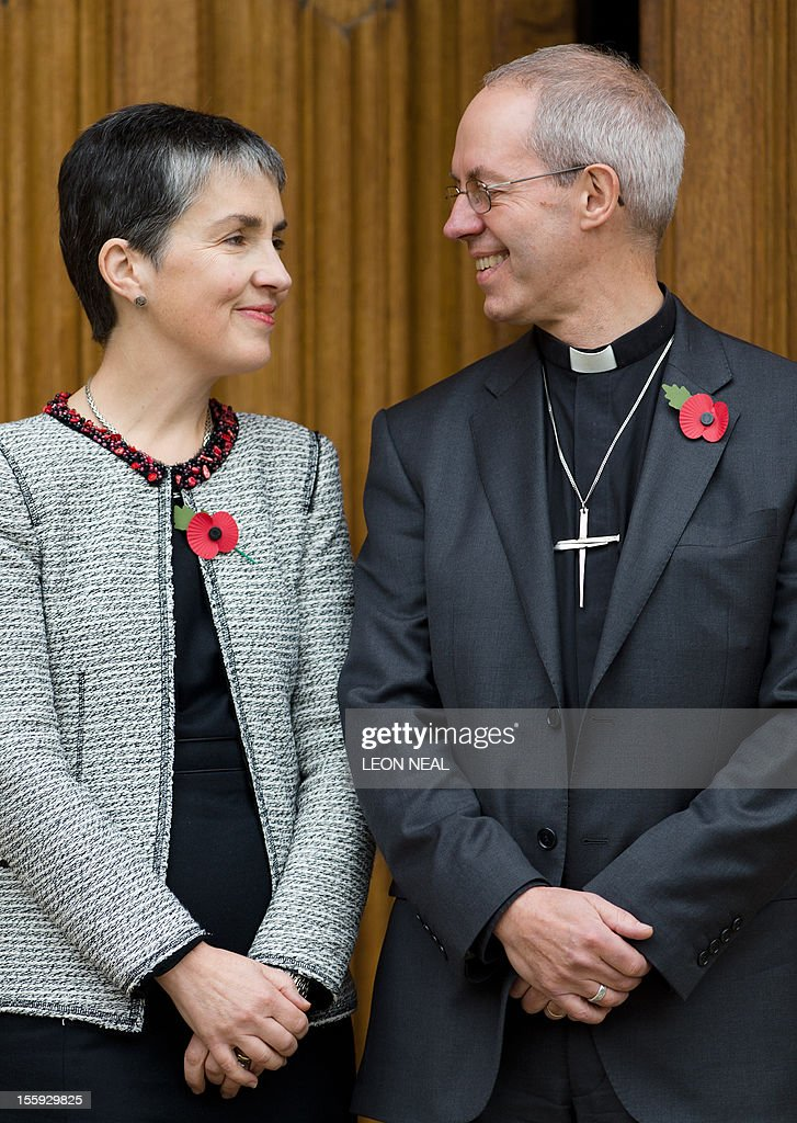 The new Archbishop of Canterbury Justin Welby (R) poses for pictures with his wife Caroline following a press conference in London, on November 9, 2012. Former oil executive Justin Welby was named Friday as the next Archbishop of Canterbury, the spiritual head of the world's Anglicans, in a move aimed at healing schisms over gay and female bishops.
