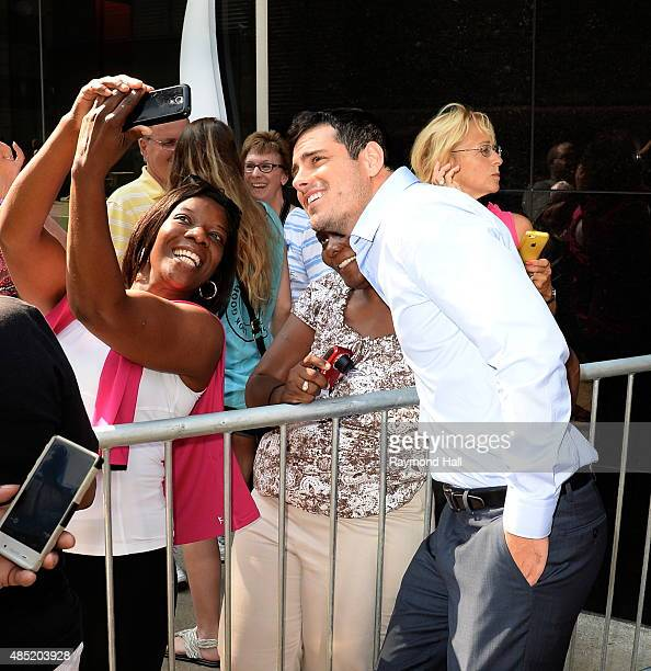 The New Bachelor Ben Higgins is seen walking in Times Square on August 25 2015 in New York City