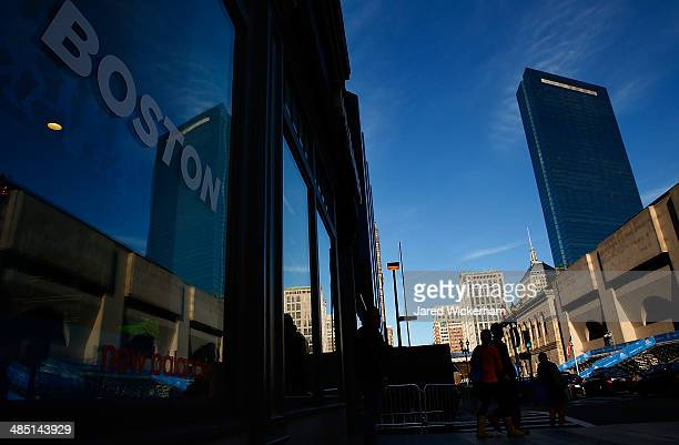 The New Balance store window reflects the cityscape near the finish line of the Boston Marathon on April 16 2014 in Boston Massachusetts