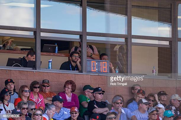 The new baseball clock shown counting down between innings during a spring training game between the San Francisco Giants and the Oakland Athletics...