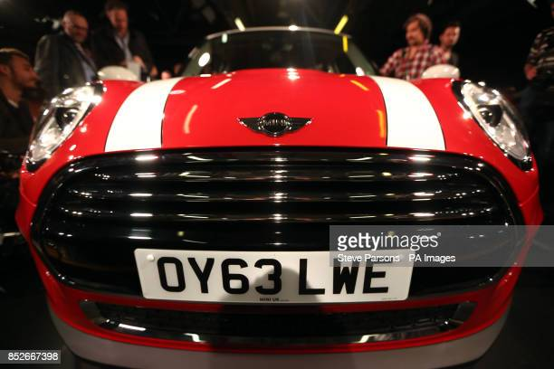 The new BMW Mini is unveiled at their plant in Oxford to coincide with the 107th anniversary of the birth of the car's designer Sir Alec Issigonis