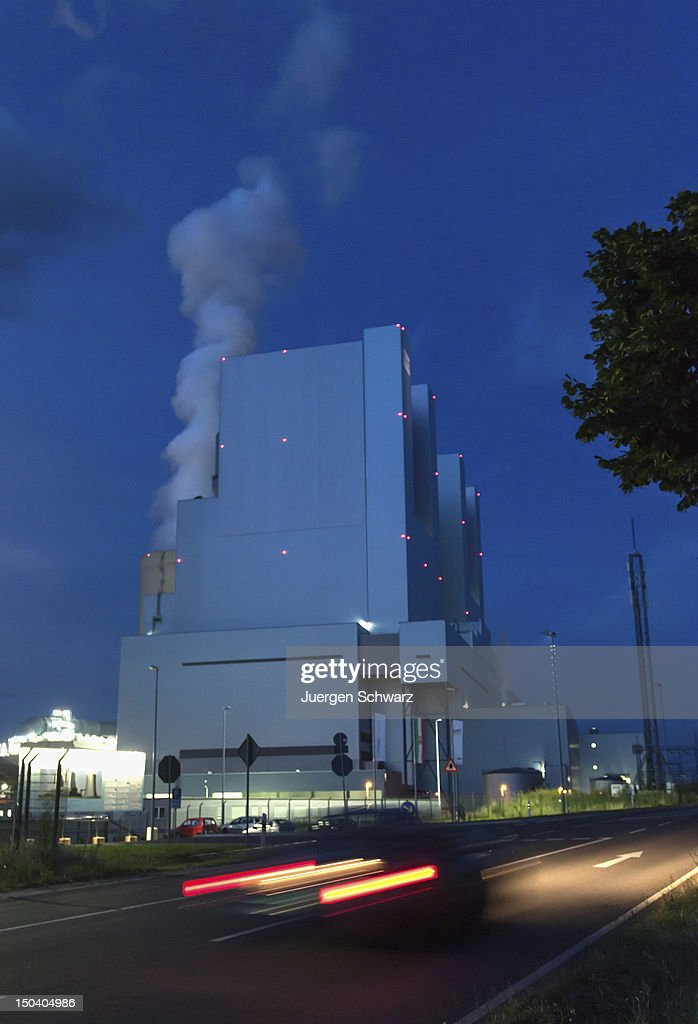 The new BoA 2&3 coal-burning power plant stands at twilight the day after it officially went into operation on August 16, 2012 near Grevenbroich, Germany. The plant, which is operated by German power company RWE, is rated at 2,200 Megawatts, making it the biggest coal-fired plant in Europe. Though Germany is among world nations leading in investments in renewable energy sources, supporters of the BoA 2&3 argue the plant is necessary as a bridge until the capacity of renewable energy sources becomes sufficient, especially in light of Germany's commitment to phase out its nuclear power plants. According to RWE the plant will also replace 13 smaller, less-efficient coal-burning plants in the region.