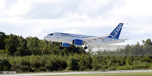 The new bombardier aircraft CSseries is shown in Mirabel Quebec after take off for the first time on September 16 2013 Bombardier Inc carried out...