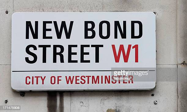 The New Bond Street sign is seen on a wall in London UK on Monday June 24 2013 Bank of England Governor Mervyn King said the global economic recovery...