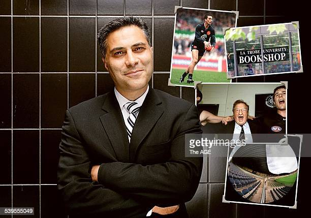 The new boss of the National Australia Bank Ahmed Fahour with photographs stuck up on the wall behind him including a picture of Stephen Silvagni...