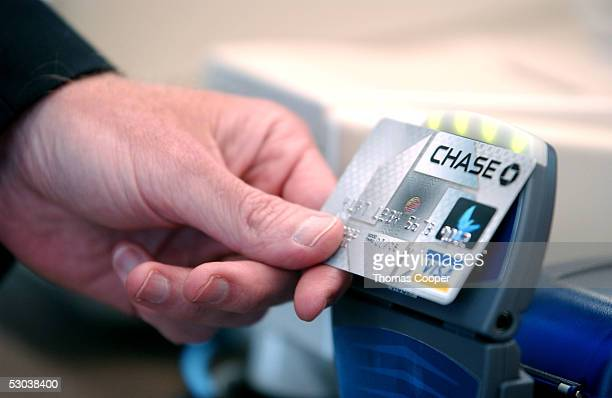 The new Chase Bank credit card with 'blink' technology is displayed during a press conference at an Arby's restaurant June 8 2005 in Denver Colorado...