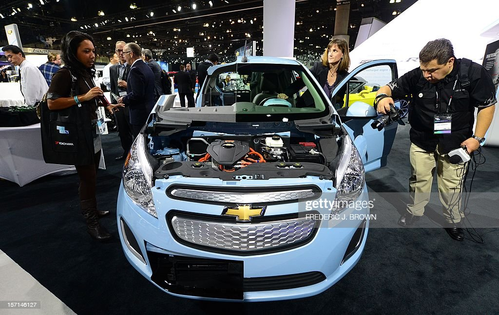 The new Chevrolet Spark EV eco-friendly car from General Motors attracts interest on media preview day at the Los Angeles Auto Show on November 28, 2012 in Los Angeles, California. General Motors has said it will integrate Apple's voice-activated software Siri in some of its cars next year to allow iPhone users to perform hands-free tasks, announcing at the LA Auto Show it will use the Siri intelligent assistant in the Chevrolet Spark and Sonic LTZ and RS. AFP PHOTO / Frederic J. BROWN