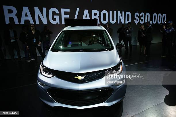 The new Chevy Bolt EV an electric car with a battery range of 200 miles priced at $30 and will be in production this year is seen on stage after a...