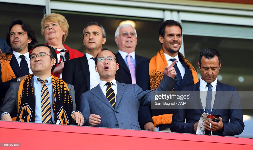 The new Chinese owners, Jeff Shi of Fosun International Limited and Wolverhampton Wanderers, Guo Guangchang the chairman of Fosun International Limited owner of Wolverhampton Wanderers and Jorge Mendes Sports Agent during the Sky Bet Championship match between Rotherham United v Wolverhampton Wanderers at The New York Stadium on August 6, 2016 in Rotherham, England.