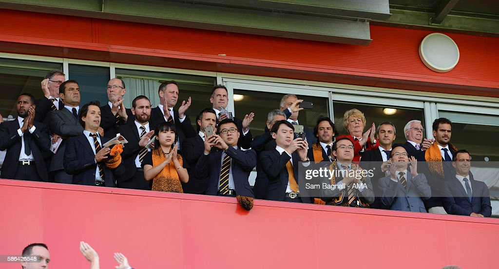The new Chinese owners of Wolverhampton Wanderers, Jeff Shi of Fosun International Limited and Wolverhampton Wanderers, Guo Guangchang the chairman of Fosun International Limited owner of Wolverhampton Wanderers and Jorge Mendes Sports Agent during the Sky Bet Championship match between Rotherham United v Wolverhampton Wanderers at The New York Stadium on August 6, 2016 in Rotherham, England.