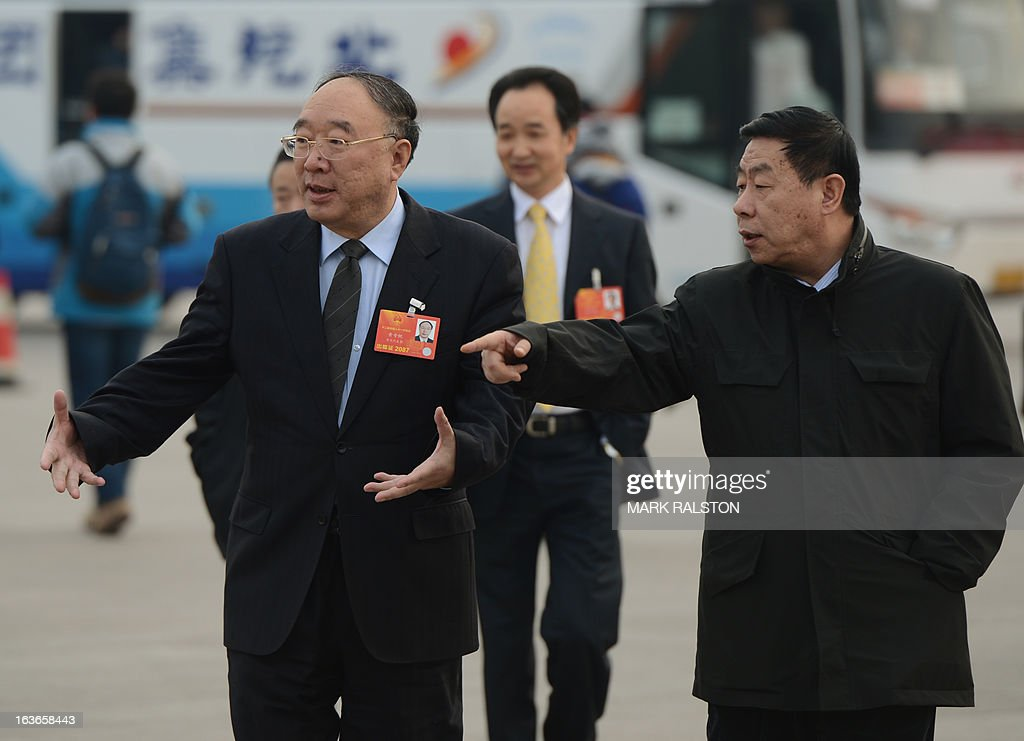 The new Chongqing mayor Huang Qifan (L) arrives for the election of the new president of China during the 12th National People's Congress (NPC) in the Great Hall of the People in Beijing on March 14, 2013. Chinese Communist Party leader Xi Jinping was named president of the world's most populous country after a vote at its parliamentary meeting in Beijing. AFP PHOTO/Mark RALSTON