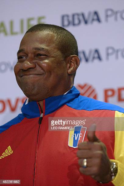 The new coach of the Venezuelan football team Noel 'Chita' Sanvicente gives the thumbs up during his official introduction in Caracas on July 17 2014...