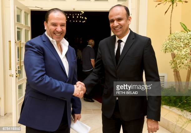 The new coach of Tunisia Football team Nabil Maaloul and the President of the Tunisian football federation Wadii Jari shakes hands prior to giving a...