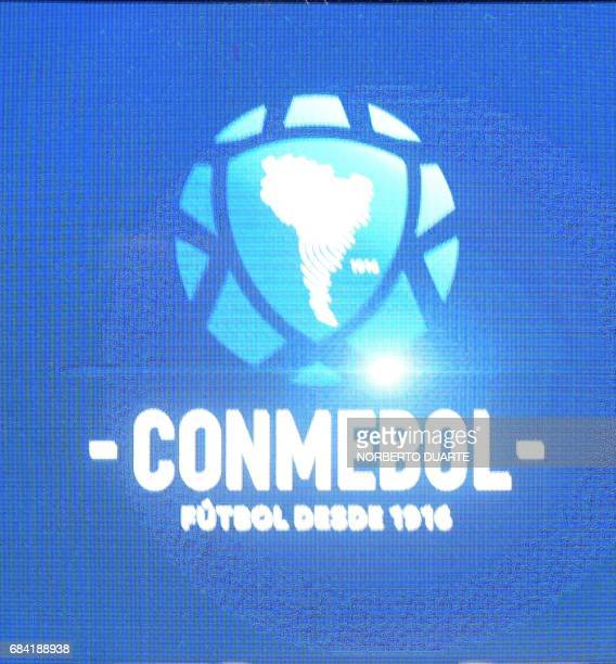 The new Conmebol logo is presented at the Conmebol headquarters in Luque Paraguay on May 17 2017 / AFP PHOTO / NORBERTO DUARTE