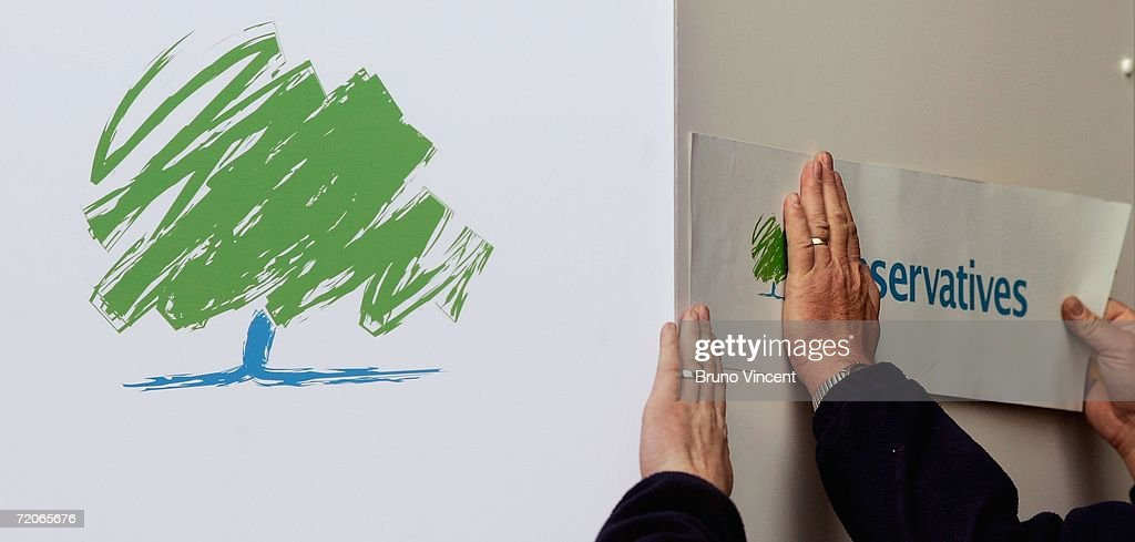 The new Conservative party logo is stuck to a wall on October 2 2006 in Bournemouth England In his first party conference as Tory leader David...