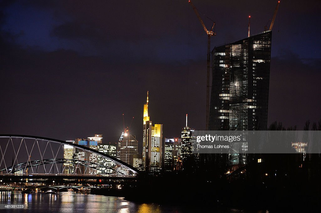 The new construction for the European Central Bank (ECB) stands on the eastside of Frankfurt with the skycrapers of the skyline illuminated in the twilight in the background on January 07, 2014 in Frankfurt am Main, Germany. Many skycrapers in the financial district belong to leading European banks.