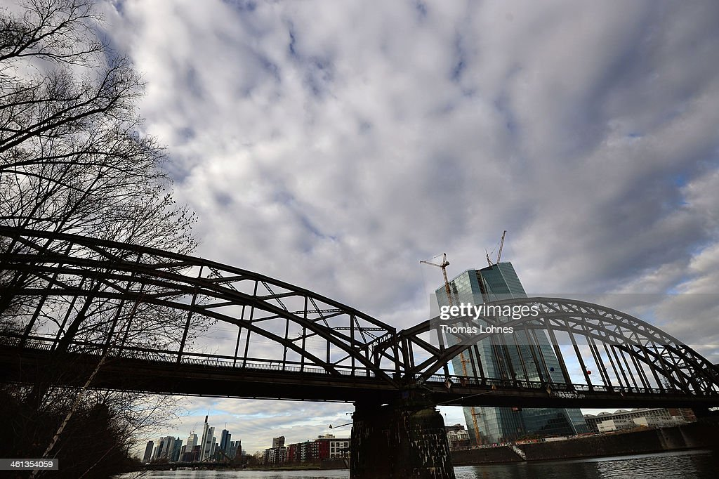 The new construction for the European Central Bank (ECB) stands on the eastside of Frankfurt with the skycrapers of the skyline illuminated in the background on January 07, 2014 in Frankfurt am Main, Germany. Many skycrapers in the financial district belong to leading European banks.