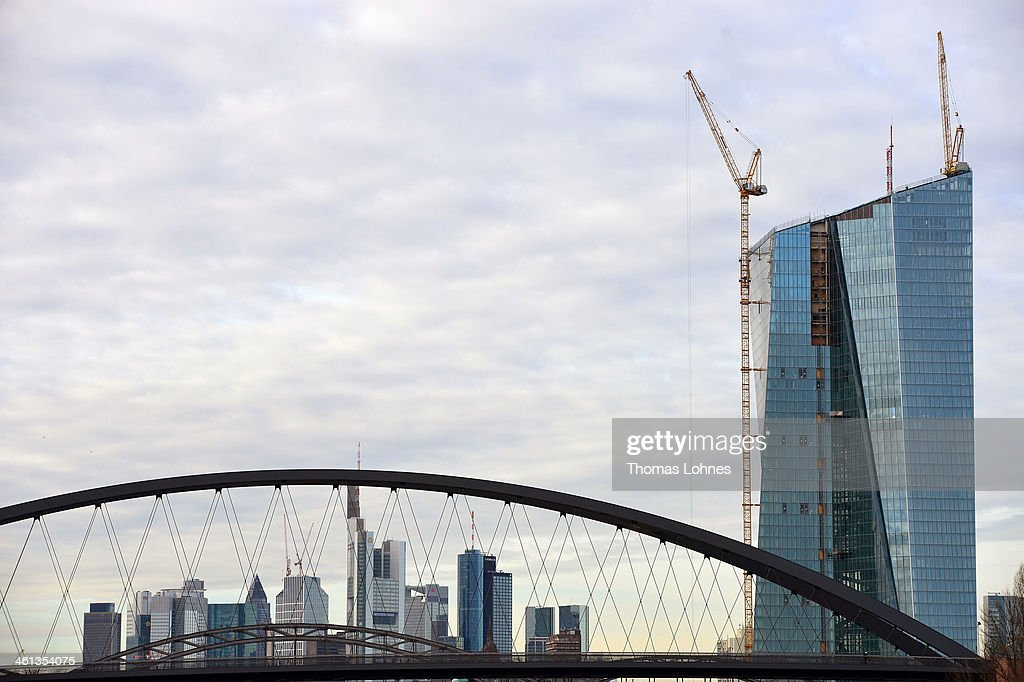 The new construction for the European Central Bank (ECB) stands on the eastside of Frankfurt with the skycrapers of the skyline in the background on January 07, 2014 in Frankfurt am Main, Germany. Many skycrapers in the financial district belong to leading European banks.