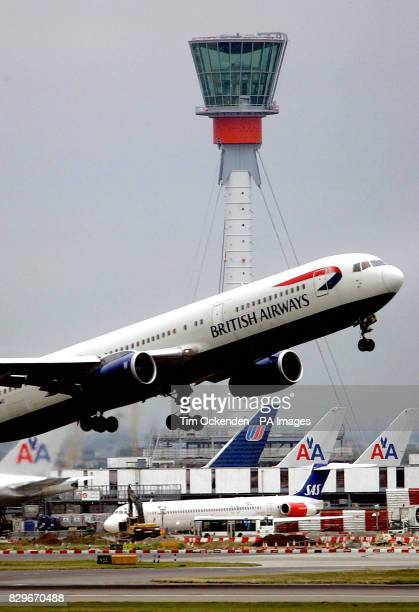 The new control tower at Heathrow airport London supported by an 85mhigh 46m diameter triangular steel mast anchored to the ground with three pairs...