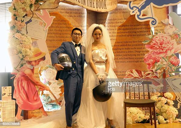 The new couple poses for a photo at a bookstore where they hold a wedding ceremony on February 12 2017 in Chongqing China They believe that bookstore...