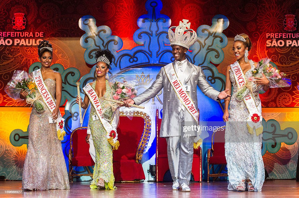The new court of Sao Paulo's Carnival (L to R) second Princess Jessica Cristine da Silva, Queen Ariellen da Silva Domiciano, King Momo Gledson Fonseca and first Princess Kimberylin Muriel, pose at the end of the competition for new King, Queen and Princess of the Carnival parade in Sao Paulo, Brazil, late on January 17, 2013. Sao Paulo's carnival is scheduled for February 8 and 9.