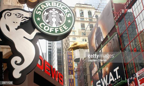 The new design of the Starbucks Coffee sign featuring a 7 foot Siren the temptress character in the chain's logo is seen among other 42nd Street...