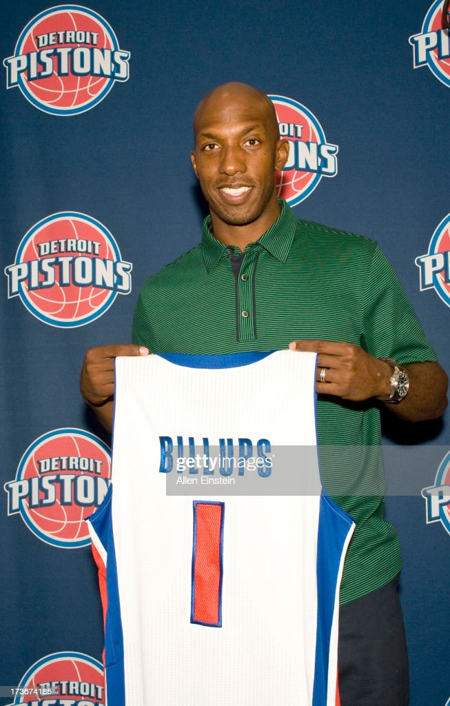 The new Detroit Piston, Chauncey Billups poses with his new jersey, presented by President of Basketball Operations Joe Dumars, at a press conference at Palace of Auburn Hills on July 16, 2013 at Palace of Auburn Hills in Auburn Hills, Michigan.