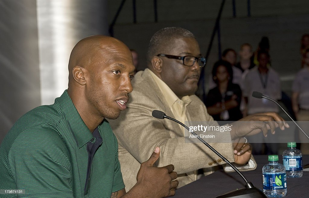 The new Detroit Piston, Chauncey Billups, speaks at a press conference at Palace of Auburn Hills as Joe Dumars, President of Basketball Operations (R), listens on July 16, 2013 at Palace of Auburn Hills in Auburn Hills, Michigan.