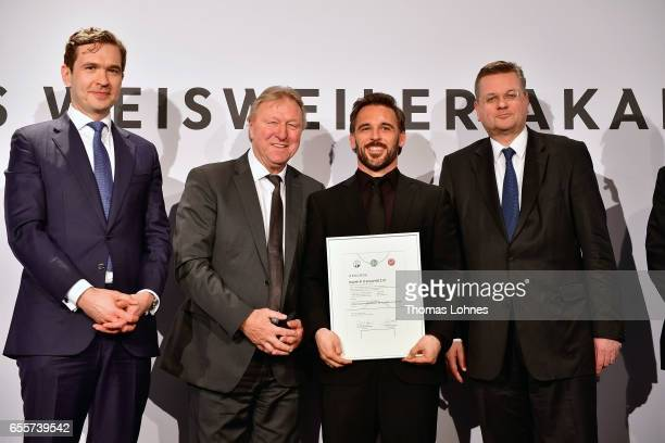 The new DFB football coach Damir Dugandzic stands with his certificate between DFB general secretary Friedrich Curtius Horst Hrubesch and DFB...