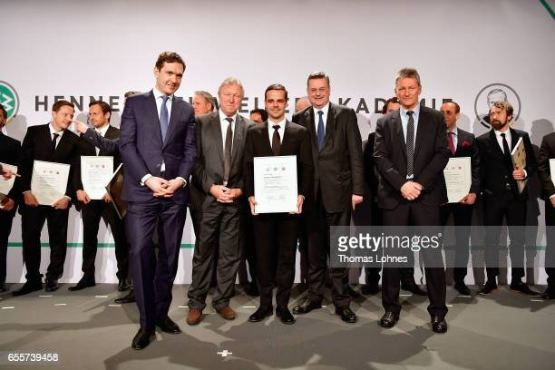 The new DFB football coach Daniel Petrowsky stands with his certificate between DFB general secretary Friedrich Curtius Horst Hrubesch DFB president...