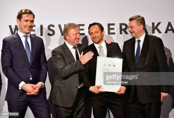 The new DFB fototball coach Heiko Gerber stands with his certificate between DFB general secretary Friedrich Curtius Horst Hrubesch and DFB president...
