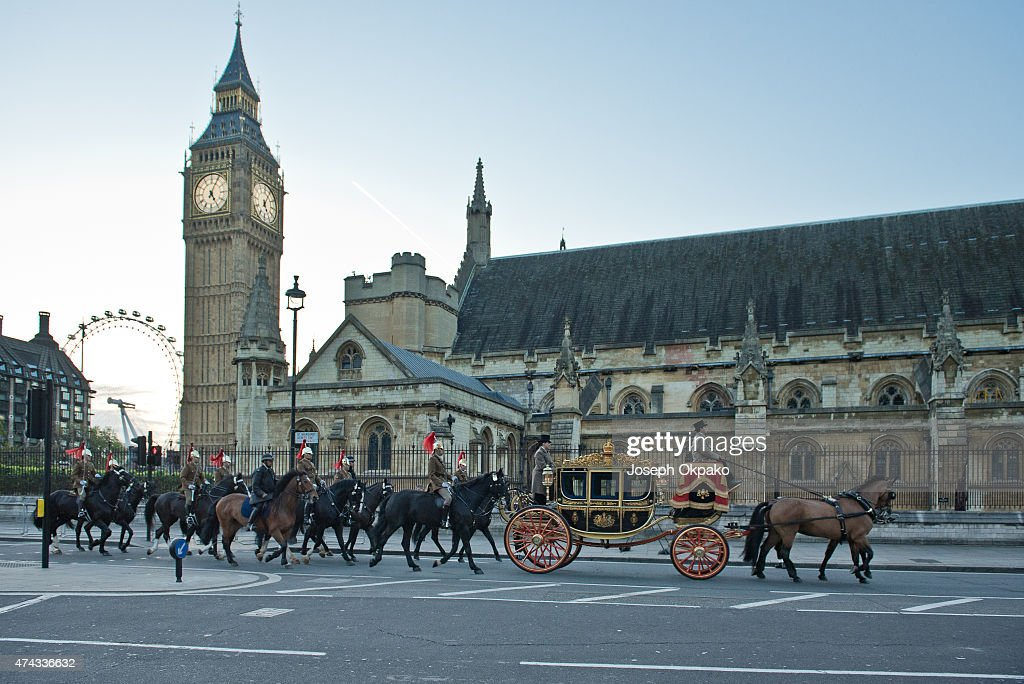 The new Diamond Jubilee state coach arrives from Buckingham Palace during the rehearsal of the State Opening of Parliament on May 22 2015 in London...