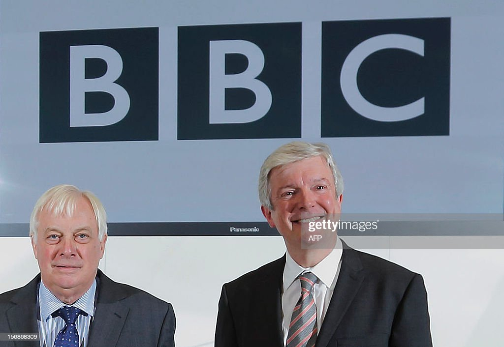 The new director-general of the BBC Tony Hall (R) poses with Chris Patten (L), the head of the BBC Trust, ahead of a press conference in London on November 22, 2012. Tony Hall, the chief executive of Britain's Royal Opera House, was Thursday named director-general of the BBC after his predecessor quit over the corporation's reporting of child sex abuse. AFP PHOTO / JUSTIN TALLIS