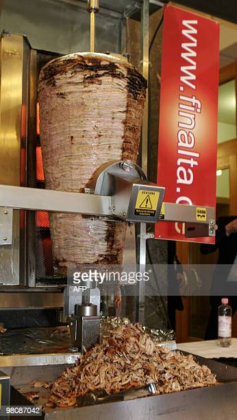 The new doner kebabcutting robot slices kebab meat during the 'Doga' doner gastronomy trade fair in Berlin on March 27 2010 Doner kebabcutting robot...