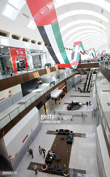 The new Dubai Mall shopping centre is decorated with national flags hours before its official opening in the oilrich Gulf emirate on November 4 2008...