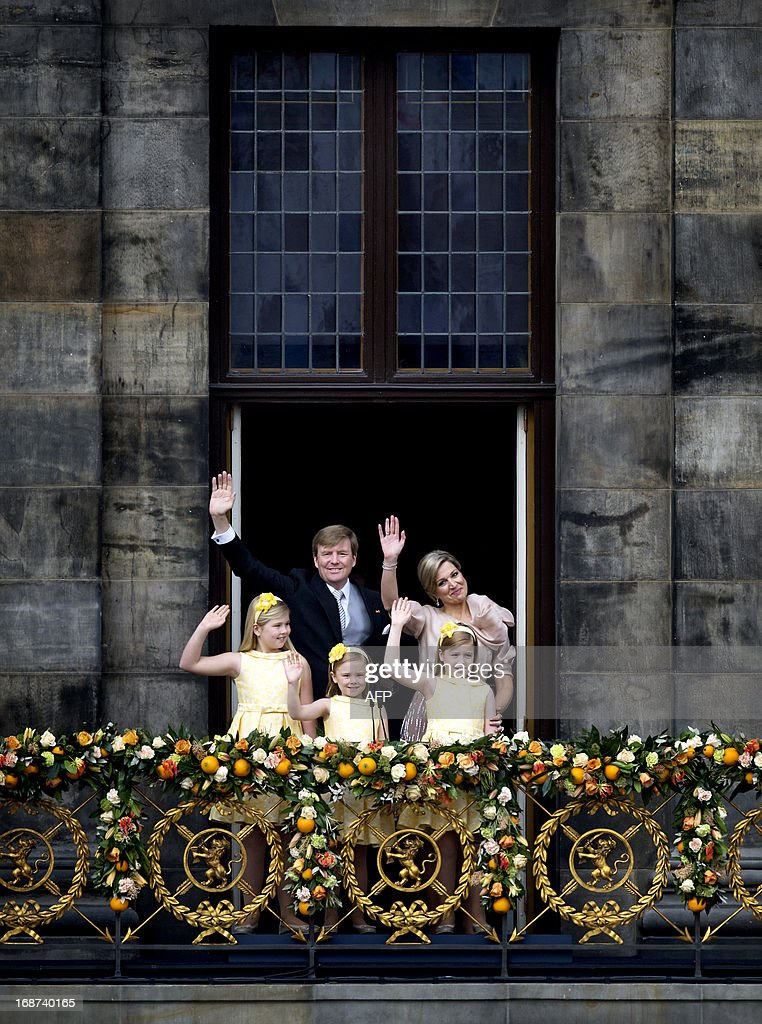 The New Dutch King Willem-Alexander, Queen Maxima and their daugthers (from L) Crown Princess Amalia, Princess Ariane and Princess Alexia wave on the balcony after the abdication ceremony of the King's mother at the Royal Palace in Amsterdam, The Netherlands, on April 30, 2013. Dutch King Willem-Alexander was sworn in at a solemn ceremony on Tuesday under the watchful eye of the cream of Europe's monarchs-in-waiting, who are no doubt wondering whether they will be next. AFP PHOTO / ANP - MARTIJN BEEKMAN = netherlands out
