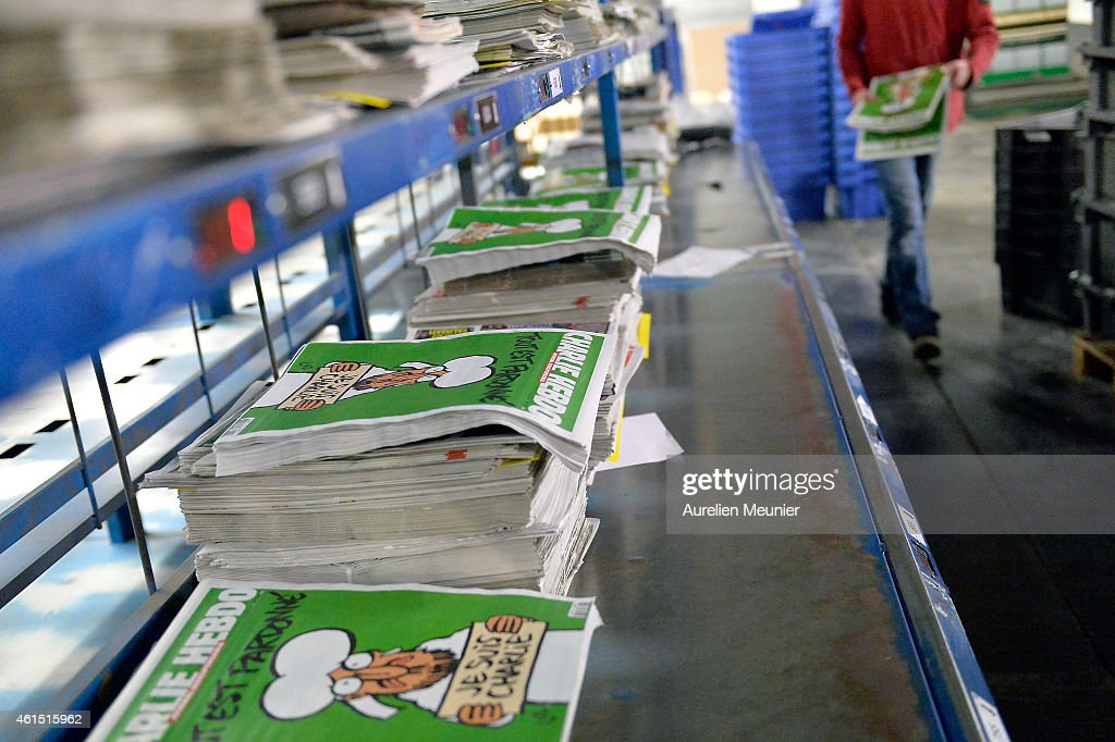 The new edition of Charlie Hebdo is prepared for delivery in a press distribution center in the suburbs on January 14 2014 in MarnelaVallee France...