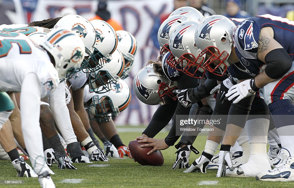 The New England Patriots and the Miami Dolphins line up at the line of scrimmage for the snap during the second half of New England's 2724 win at...